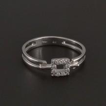 Prořezávaný prsten se zirkony bílé zlato 3529