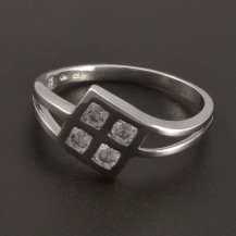 Prsten bílé zlato čtyři zirkony 7519