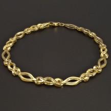 Zlatý vybrušovaný náramek