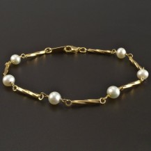Zlatý náramek s perličkami